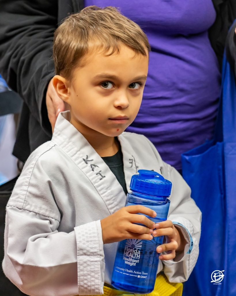 Photo of Small Boy with water bottle