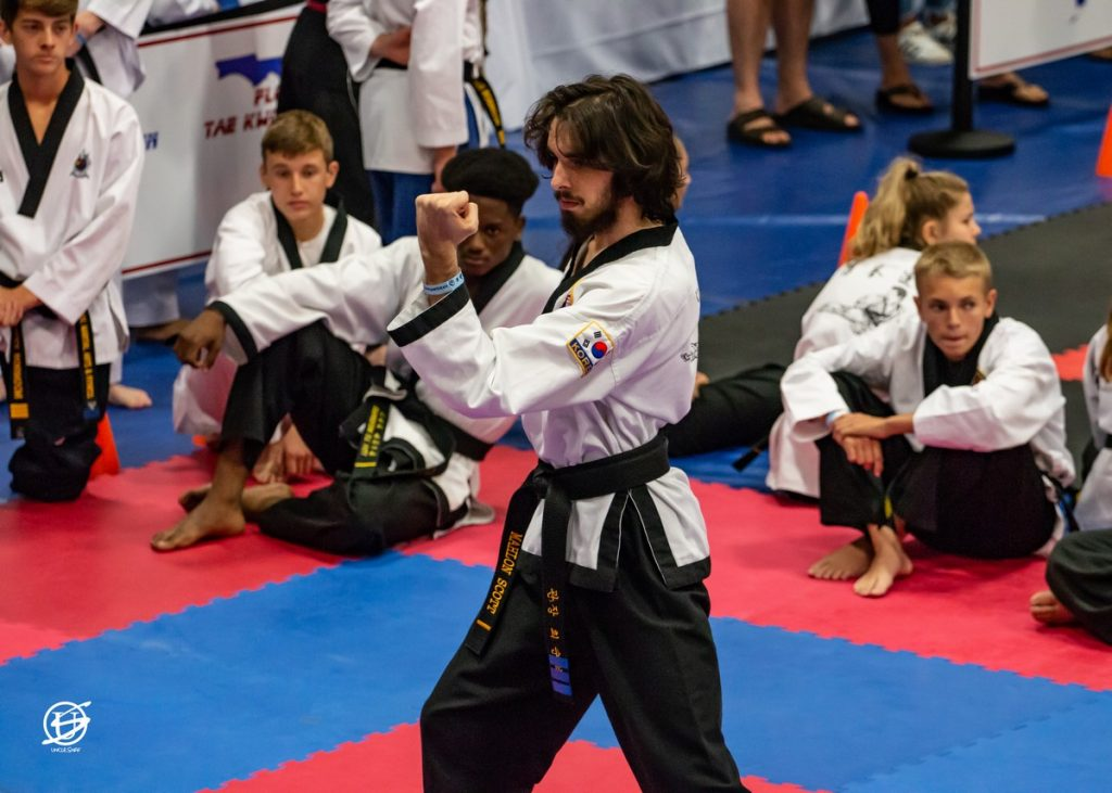 young male in uniform competes