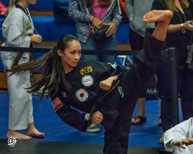 close up of young woman competing in tae kwon do tournament