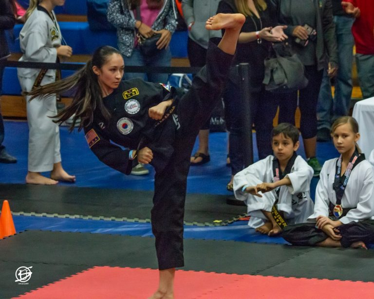 young woman competes in tae kwon do tournament