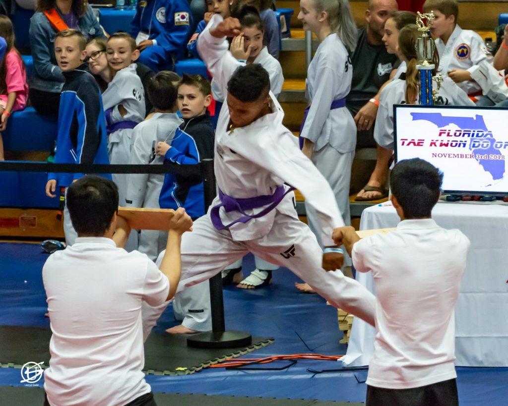 competitor preparing to break two boards in succession